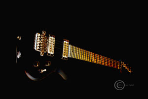 dark picture of a rock guitar